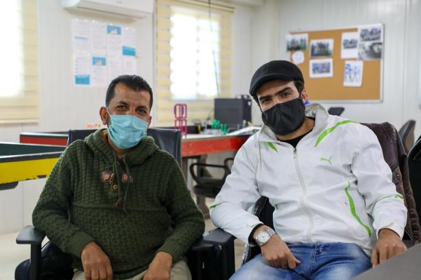 Two men seated in the Innovation Lab of Zaatari camp