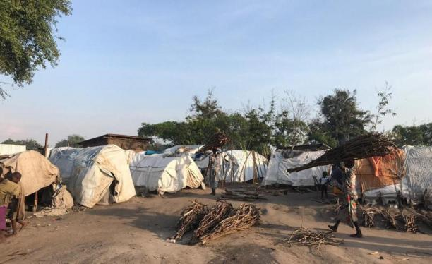 IDP camp. We can see someone walking through.