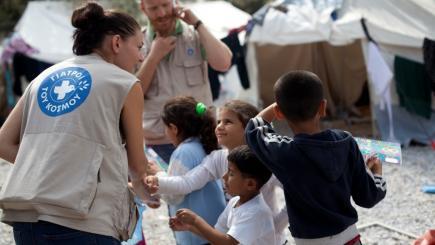 A woman from MdM Greece playing with refugee children in Kara Tepe camp in Lesvos
