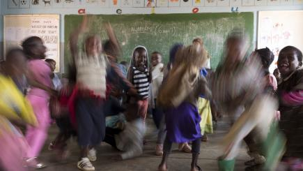 Malawi. Children singing and dancing before the start of the class at the preschool