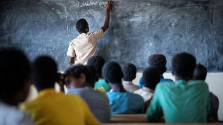Burkina Faso. A Malian refugee student plays the role of teacher at a school in Goudoubo camp