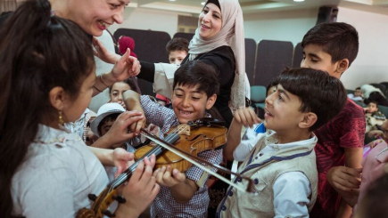 Children testing musicians violin
