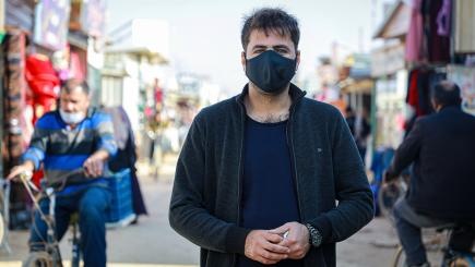 Man standing wearing a mask